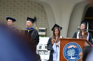A picture of me graduating with my Master's degree.